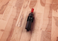 Wine Bottle PSD Mockup On Wooden Floor